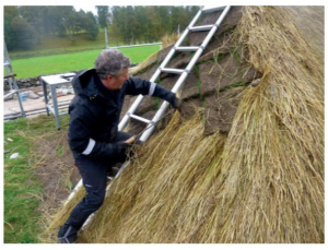 person and thatched roof